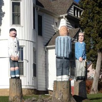 Three Stooges Chainsaw Carvings