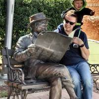 Will Rogers Reads a Newspaper