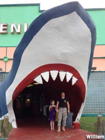 Standing in the shark mouth entrance.