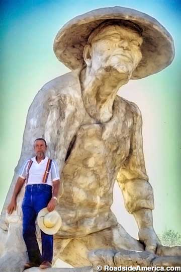 Ken Fox and one of his statues.