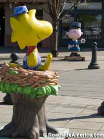 Peanuts characters on street corners.