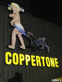 Coppertone Girl sign