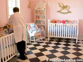 Pink nursery for the girl babies.