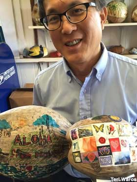 Postmaster Gary Lam and a couple of mail-ready nuts.