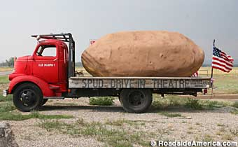Giant potato on a truckbed.