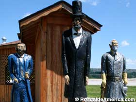 Grant, Lincoln, Lee -- chiseled in wood.