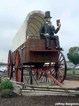 Lincoln on covered wagon.