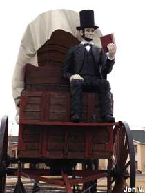 Lincoln reads on the wagon.