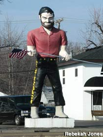 Muffler Man with American flag.