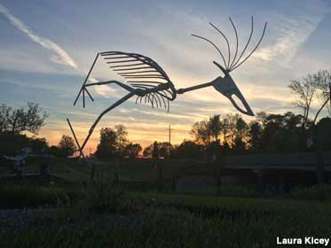 Yard art at dusk.