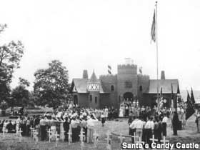 1930s view of Candy Castle with a ceremony underway that appears to involve flags, saluting and little grave marker cros