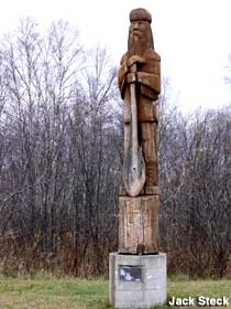 Carved statue of a Voyageur.