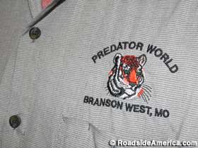 Predator World employee shirt.