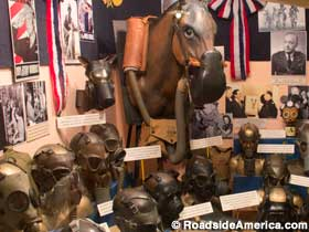 Gas mask display, including the horse, dog and Mickey Mouse masks.