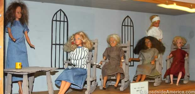 Diorama of a typical 1960s mental hospital ward features a straitjacket Barbie.