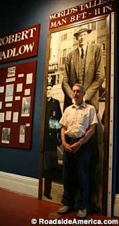 Gary stands for scale in front of the Robert Wadlow display.