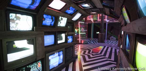 TV OD hallway leads to neon Chinatown in the multiverse. Op Art floor boosts sensory assault.