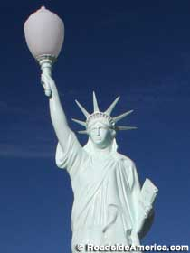 Statue of Liberty with street lamp.