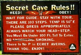 Secret Cave Rules sign.