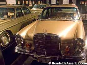 Lucy's 1972 gold Mercedes, multiplied by mirrors.