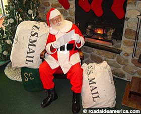 Santa reads mail in North Pole, New York.