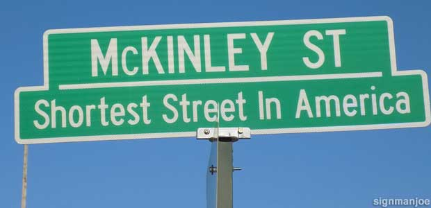 Shortest Street In America sign.