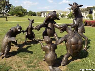 Animals sculptures dance in a circle.