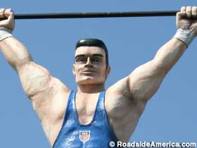 Weightlifter on sign.