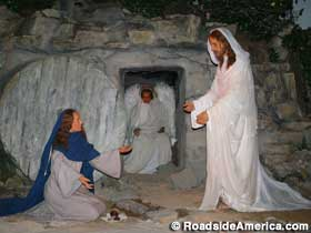 Wax scene of the almost empty tomb.