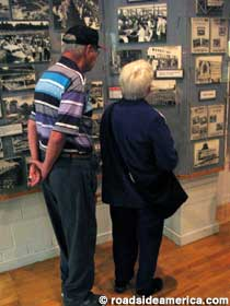 Visitors peruse old photos.