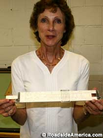 Michele shows off slide rule.