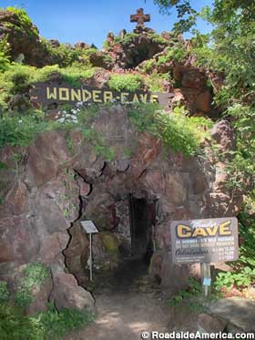Cave entrance with its cautionary sign.