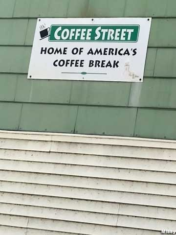 Sign for Coffee Street, Home of America's Coffee Break.